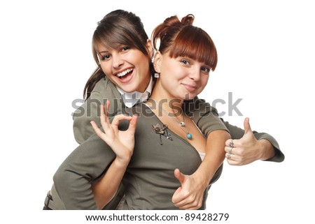 Two excited girls showing OK signs, isolated on white background - stock photo