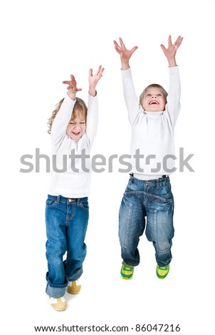 two excited kids jumping up isolated on white background - stock photo