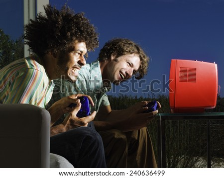 Two Excited Men Playing Console Game - stock photo