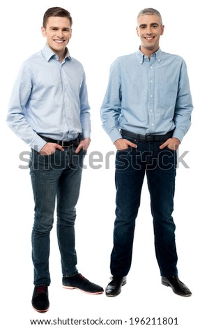Two executives standing and hand in pockets - stock photo