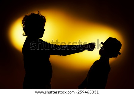 Two  expressive boy's silhouettes showing emotions using gesticulation, isolated on yellow
