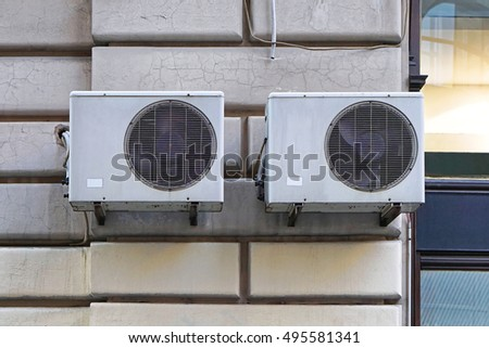 Two external air conditioner device units
