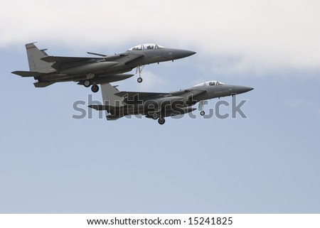 Two F15 Strike Eagle Fighters with landing gear down - stock photo