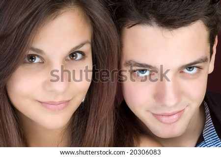 two faces, young couple - stock photo