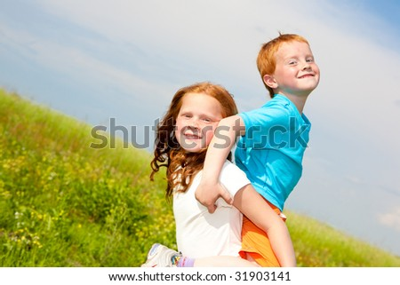 Two fan children playing the field