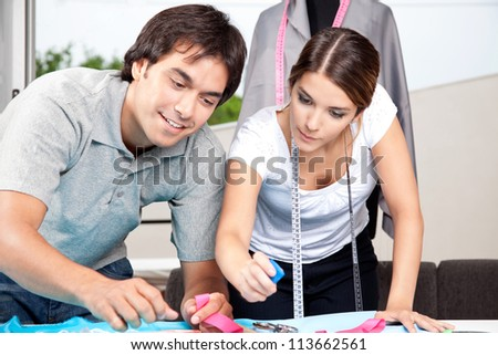 Two fashion designer working together at work place.