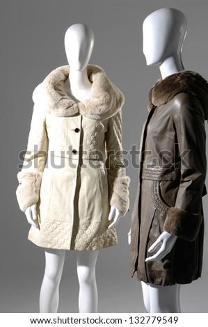 two fashion female fur coat on a dummy - stock photo