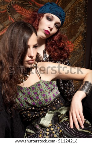two fashion girls, studio shot