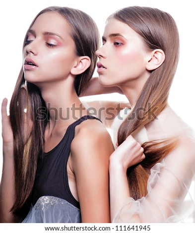two  fashion model posing in isolated background - stock photo