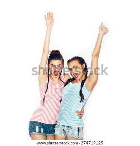 Two fashion young girl friends hugging and having fun. White background not isolated - stock photo