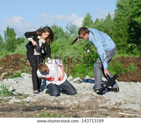 Two FBI agents arresting an offender with knife - stock photo