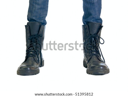 Two feet in big boots - stock photo