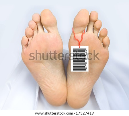 Two feet of a dead body, with an identification tag - bar code   attached to a toe. Covered with a white sheet. - stock photo