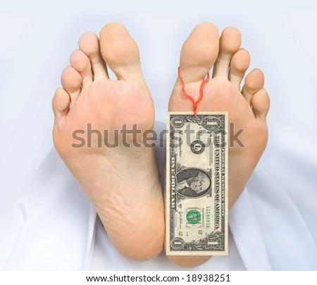 Two feet of a dead body, with banknote one dollar attached to a toe. Covered with a white sheet. - stock photo