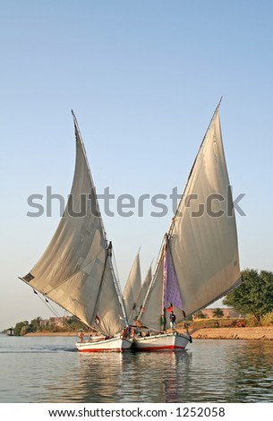 Two feluccas sailing together on Nile River, Egypt - stock photo