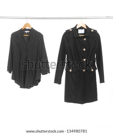 Two female black dress isolated on hanging - stock photo