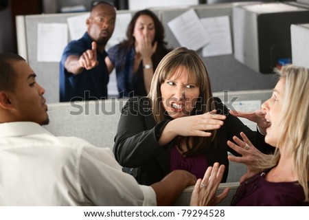 Two female coworkers fight in office cubicle - stock photo