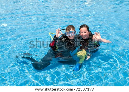 Two female divers in a swimming Pool - stock photo