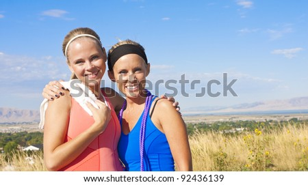 Two female friends after their workout - stock photo