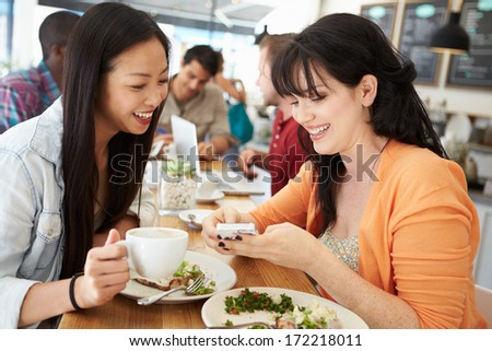 Two Female Friends Friends Meeting For Lunch In Coffee Shop - stock photo