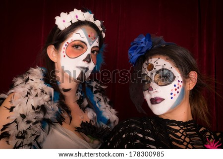 Two female friends in Day of The Dead costume and make up
