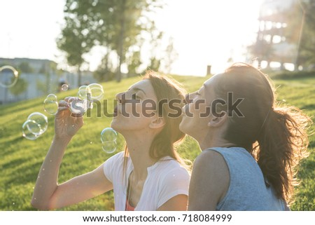 Two female friends outdoors in the city park