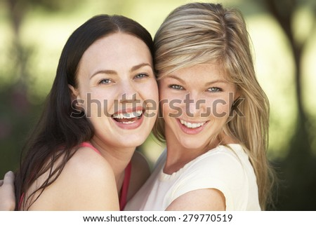 Two Female Friends Relaxing Together - stock photo
