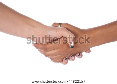 Two female hand shaking hands working together.
