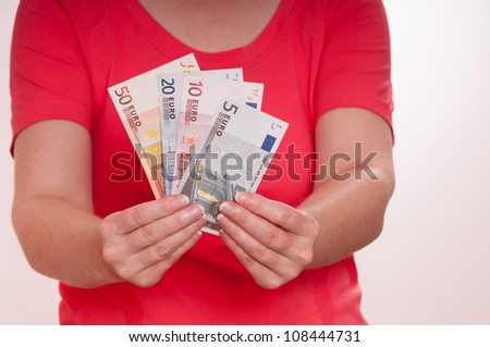 Two female hands are holding a bunch of euro notes - stock photo