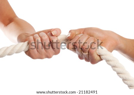 Two female hands holding rope, isolated