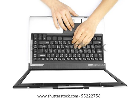 Two female hands on the laptop isolated on white background - stock photo