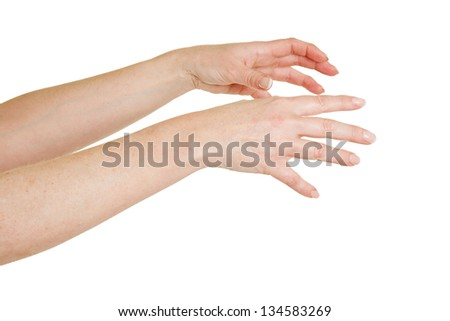 Two female hands reaching out to the right - stock photo
