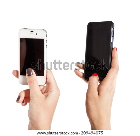 Two female hands take photos on mobile phones. Isolated on white background. - stock photo