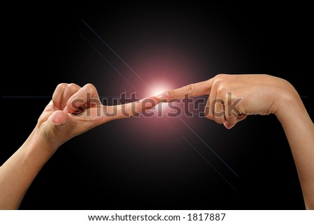 Two female hands touching together in a bright light