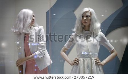 Two female mannequin in the window of the fashionable shop in gentle tones - stock photo