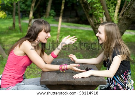 Two female meeting in a cafe - stock photo