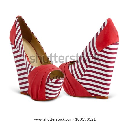 Two female platform striped shoes isolated on white background