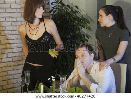 two female rivals discussing about a man - stock photo