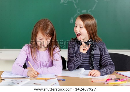 Two female students sitting and studying at school class