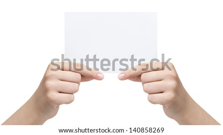 two female teen hands holding paper sheet, isolated on white - stock photo