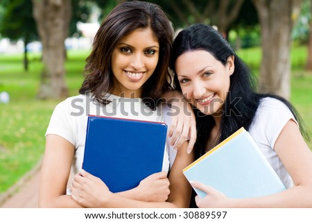two female university students in campus - stock photo
