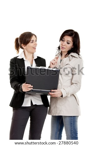 Two female young students watching something on a laptop - stock photo