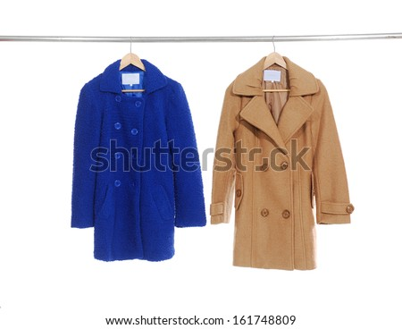 Two femaleblack clothes with coat on a hanger  - stock photo