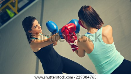 Two Females Sparring At Gym - stock photo