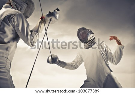 Two fencers facing each other - stock photo