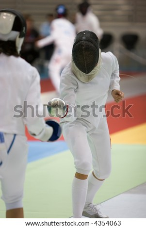 Two fencers practicing their sport - stock photo
