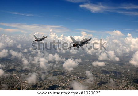 Two fighter jets flying at high altitude - stock photo