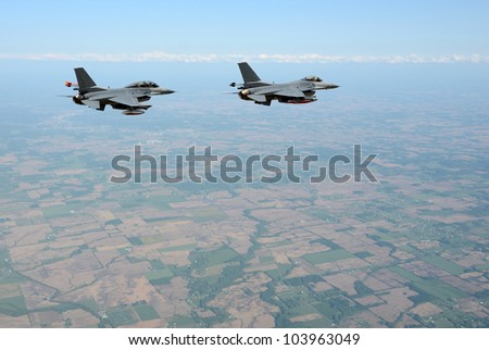 Two fighter jets flying at high altitude (rendering/collage) - stock photo