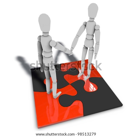 two figures are standing on a puzzle and shaking hands - stock photo