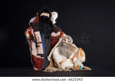 Two figures of the christmas stable : shepherds and a sheep (handmade by a teenager) - stock photo
